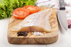 Haddock fillet on a wooden board Stock Photography