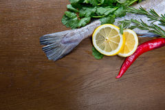 Haddock with  Lemon , pepper, Thume and cilantro Royalty Free Stock Image