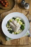 Haddock with new potatoes Royalty Free Stock Image