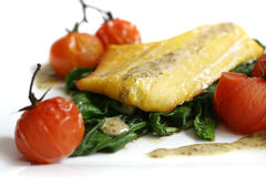 Haddock, spinach, tomatoes Royalty Free Stock Image