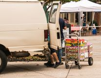A farmer unloads his fruit that he will sell at today`s farmer`s market in this small New Jersey town royalty free stock image