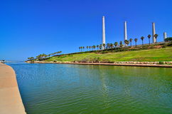 Hadera Stream in Israel. The Hadera Stream and Orot Rabin (formerly Maor David) power plant in Hadera, Israel  - super wide angle view Stock Photos