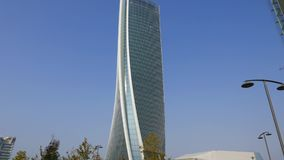 Hadid Tower in `City Life` complex in 3 Torri Milan place. Modern buildings and condos stock video