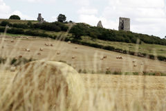 Hadleigh castle with hay bails in the foreground Royalty Free Stock Images