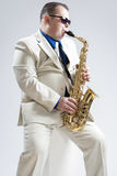 Hadnsome Male Saxophone Player Playing in Studio Stock Image