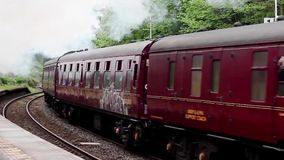 The Hadrian. Preserved steam locomotive Union of South Africa heads the Hadrian steam tour through Wetheral station, on the Settle to Carlisle railway stock video