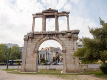 Hadrian`s gate in Athens, Greece. Hadrian`s arch with Acropolis on the background in the historic center of Athens, Greece Stock Photos