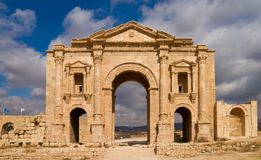 Hadrian's Arch. In the ancient roman town Jerash in Jordan. Built AD 129 to honour the visiting emperor. Sunny light, nice contrast of clouds and blue sky in Royalty Free Stock Photography