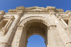 Hadrian`s Arch in the ancient roman town Jerash in Jordan. Hadrian`s Arch in the ancient roman town Jerash in North Jordan Stock Photo