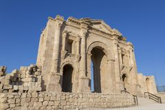 Hadrian`s Arch in the ancient roman town Jerash in Jordan. Hadrian`s Arch in the ancient roman town Jerash in North Jordan Royalty Free Stock Images