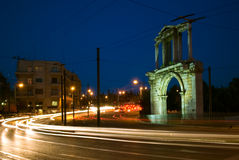 Hadrian's Arch, Athens. Hadrian's Arch at a busy intersection of Athens Greece, during twilight hour Royalty Free Stock Image