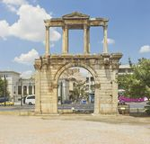 Hadrian's Arch in Athens, Greece. Hadrian's Arch in Athens, , Greece with the street and Parthenon seen in the background in summer Stock Images