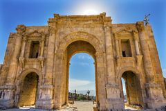 Hadrian`s Arch Gate Sun Ancient Roman City Jerash Jordan. Jerash came to power 300 BC to 100 AD and was a city through 600 AD. Not conquered until 1112 AD by Stock Images