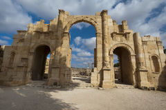 Hadrian's Arch, gateway to Roman ruins. Hadrian's Arch, main gate to Roman ruins at Jerash, Jordan Stock Photography