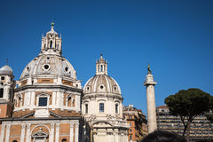 Hadrian`s Column and twin churches near the Roman Forum in Rome Italy Stock Image