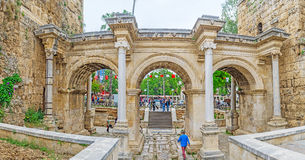 The Hadrian`s Gate in Antalya. ANTALYA, TURKEY - MAY 6, 2017: The walk through the Hadrian`s Gate, connecting old Kaleici with modern Ataturk Avenue, on May 6 in Royalty Free Stock Photos