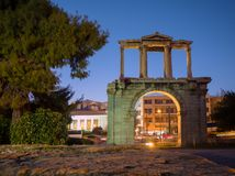 Hadrian`s gate at night in Athens stock photo