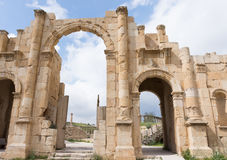 Hadrian`s Gate Jerash. Eleven meter high three arched gate with acanthus bases, capitals at the bottom of the columns, built to honor Roman Emperor Hadrian`s Royalty Free Stock Image