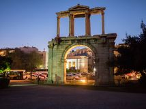 Hadrian`s gate at night in Athens. Hadrian`s gate illuminated at night with Acropolis on the background in the historic center of Athens, Greece Royalty Free Stock Photography