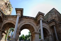 Hadrian`s Gate panorama. Ancient construction in the old town in Antalya stock image
