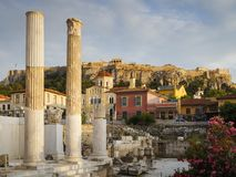 Hadrian`s Library and Acropolis. Remains of Hadrian`s Library and Acropolis in the old town of Athens, Greece Royalty Free Stock Photos