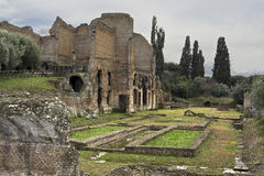 Hadrian`s Villa. Villa Adriana in Italian was constructed at Tibur as a retreat from Rome for the Roman Emperor Hadrian during the early 2nd century AD.  Tibur Royalty Free Stock Images