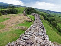 Hadrian's Wall. Is a stone and timber fortification built by the Roman Empire across the Northern England.  It was made a UNESCO World Heritage Site in 1987 Royalty Free Stock Images