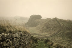 Hadrian's Wall Fog. An early morning fog has descended over Hadrian's wall in Northumberland, England, close to the Scottish border Royalty Free Stock Images