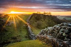 Hadrian`s Wall, Northumberland. Hadrian`s Wall looking west at sunset from Walltown Crags Stock Photography