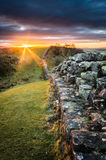 Hadrian`s Wall, Northumberland. Portrait shot of Hadrian`s Wall at Walltown Crags as the sun is setting Stock Photos