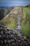 Hadrian`s Wall, Northumberland. Steep section of Hadrian`s Wall on Whin Sill at Walltown Crags Royalty Free Stock Photography