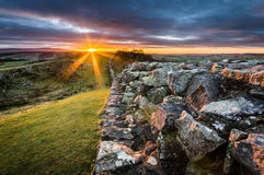 Hadrian`s Wall, Northumberland. Hadrian`s Wall at Walltown Crags on a winter`s day at sunset Royalty Free Stock Image