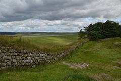 Hadrians Wall. A view of Hadrian's Wall in England, looking towards Housesteads Fort Royalty Free Stock Photos