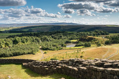Hadrians Wall above old quarry. Hadrians Wall is a World Heritage Site at the start of the beautiful Northumberland National Park Stock Images