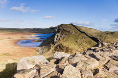 Hadrians Wall and Crag Lough. Hadrians Wall on the Whin Sill passing Crag Lough Royalty Free Stock Images