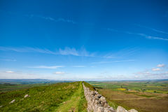 Hadrians Wall disappearing into distance of a big sky and landscape Royalty Free Stock Image