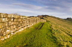 Hadrians Wall marches on. Hadrians Wall meanders into the distance Royalty Free Stock Image