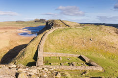 Hadrians Wall milecastle. 39 at Steel Rigg with Crag Lough behind Stock Photography