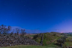 Hadrians Wall near Walltown at night. Moonlit Hadrians Wall is in the recently awarded Dark Sky Park in Northumberland Royalty Free Stock Photos