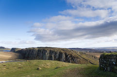 Hadrians Wall on Steel Rigg. Hadrians Wall built on the Whin Sill at Steel Rigg Stock Photos