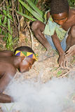 Hadzabe bushmen lighting a fire Royalty Free Stock Photo