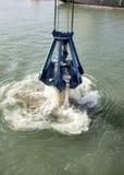 Hafen-Ausbaggern Stockbild