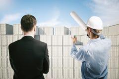 Hafenarbeiter und Geschäftsmann Lizenzfreie Stockbilder