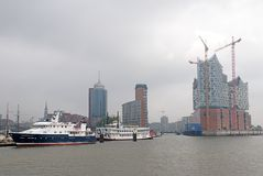 Hafencity Hamburg in fog. The elbphilharmonie in the harbor city Hamburg under construction Royalty Free Stock Photos