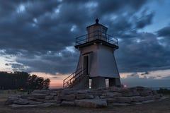 Hafenclinton-Leuchtturm genommen bei Sonnenuntergang lizenzfreie stockfotografie