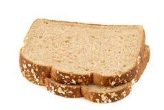 Hafer-Brot-Scheiben auf Weiß Stockfotografie