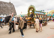 Haflinger Horses pulling beer barrels at Oktoberfest. MUNICH, GERMANY - SEPTEMBER 19: People posing in front of the horses pulling beer barrels on the stock image