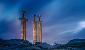 3 swords in rock in hafrsfjord stock photography