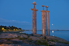 Hafrsfjord Swords in Rock night. Swords in Rock is a commemorative monument located at the Hafrsfjord fjord, Norway Stock Image