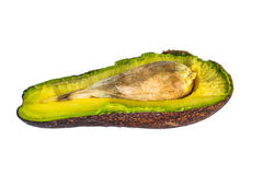 Haft of avocado over white background Stock Images